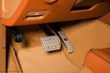 Porsche Cayenne перетяжка панели кожей